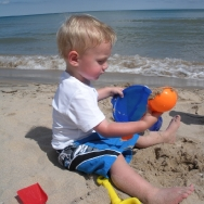 Chase playing in the sand at the beach (7/24/10)