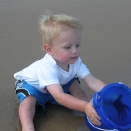 Chase trying to catch the water with a bucket (7/24/10)