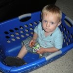 Chase in the laundry basket playing with his Woody and Buzz toys (6/21/10)