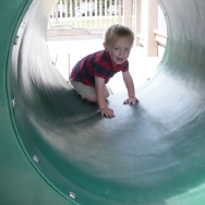Chase going thru the tube at the playground (8/20/10)