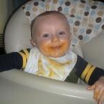 Chase enjoying his sweet potatoes (7/20/09)