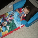 Chase chilling in his Mickey couch watching a movie (7/3/10)