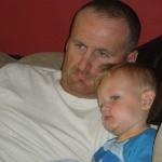 Snuggling with Dadda (7/10/10)
