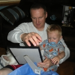 Chase helping Joe opening his Father\'s Day gifts (6/20/10)