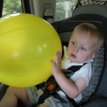 Chase holding his prized balloon (6/20/10)